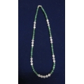 Stringed necklace made of green onyx, rose quartz and silver rings